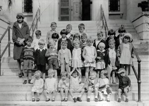 black and white photo of kids on a step