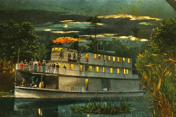 Old postcard of steamboat on Florida river at night.