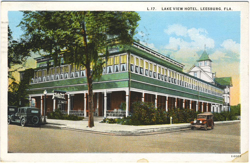Vintage postcard showing Lake View Hotel in Leesburg with old fashioned car in front.