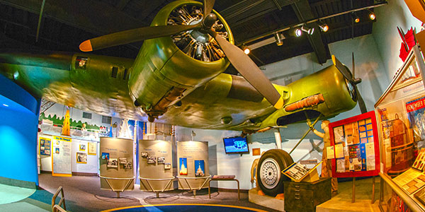 The wing of a World War II bomber plans frames the History Center's aviation exhibit