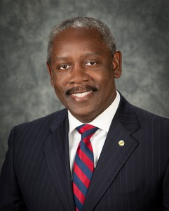 Headshot of Orange County Mayor Jerry L. Demings wearing red and blue striped tie